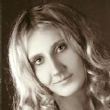 Manuela L.